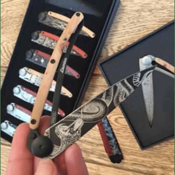 black folding knife with snake print
